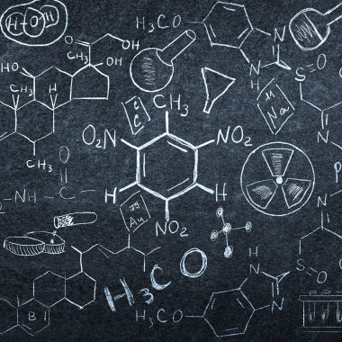 Background image with chemistry lesson drawings on chalkboard